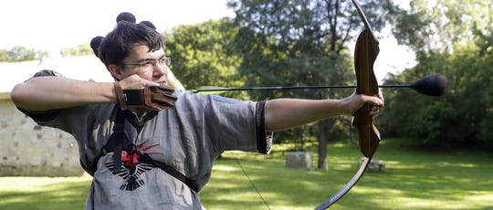 Jonathon Buss fires soft arrows during the weekly gathering of the Crimson Circle, a Green Bay-based Amtgard chapter,  at Pamperin Park in Howard.