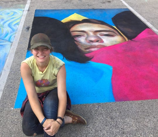 Professional chalk artist Julie Jilek, shown with some of her art, will draw on the sidewalks of Sturgeon Bay on Sept. 15 as part of Chalk the Bay.