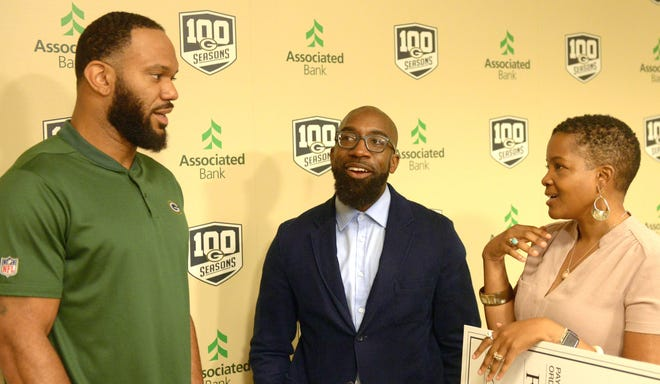 Green Bay Packers tight end Lance Kendricks talks to Maanaan Sabir and JoAnne Sabir of Sherman Phoenix Project Tuesday, Sept. 11, 2018, at Lambeau Field. Kendricks chose Sherman Phoenix Project in Milwaukee to receive $50,000 as part of a community action initiative.