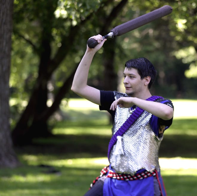 Crimson Circle member Andrew Beiderwieden participates in Amtgard, a live action role playing society  at Pamperin Park in Howard.