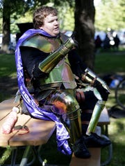 Christopher Baker of Green Bay talks about his involvement with Amtgard, a live action role-playing and combat society, during a local event at Pamperin Park in Howard.