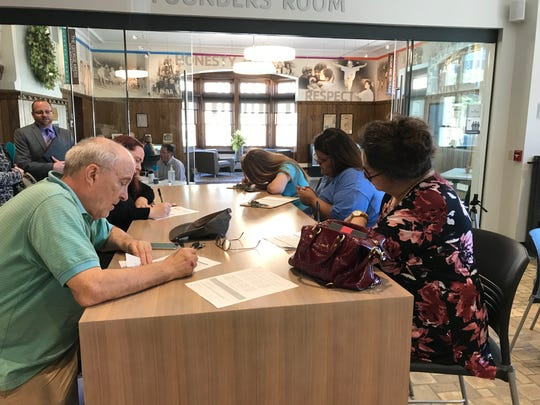 Job seekers fill out applications Tuesday afternoon at the Hotel Northland job fair at the Ferguson Family YMCA in downtown Green Bay. The job fair will also be held Sept. 12, 18, and 19.
