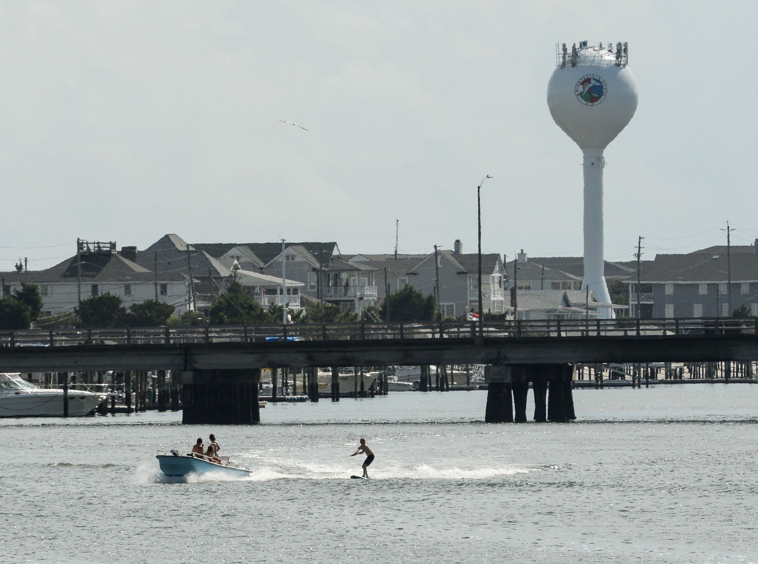 A boat pulls a water skier on the waterway near Wrightsville Beach in Wilmington, North Carolina on Tuesday, September 11, 2018. Hurricane Florence is expected to arrive in Wilmington, North Carolina late Thursday night through Friday morning. (Ken Ruinard / Greenville News / Gannett USA Today Network / 2018 )