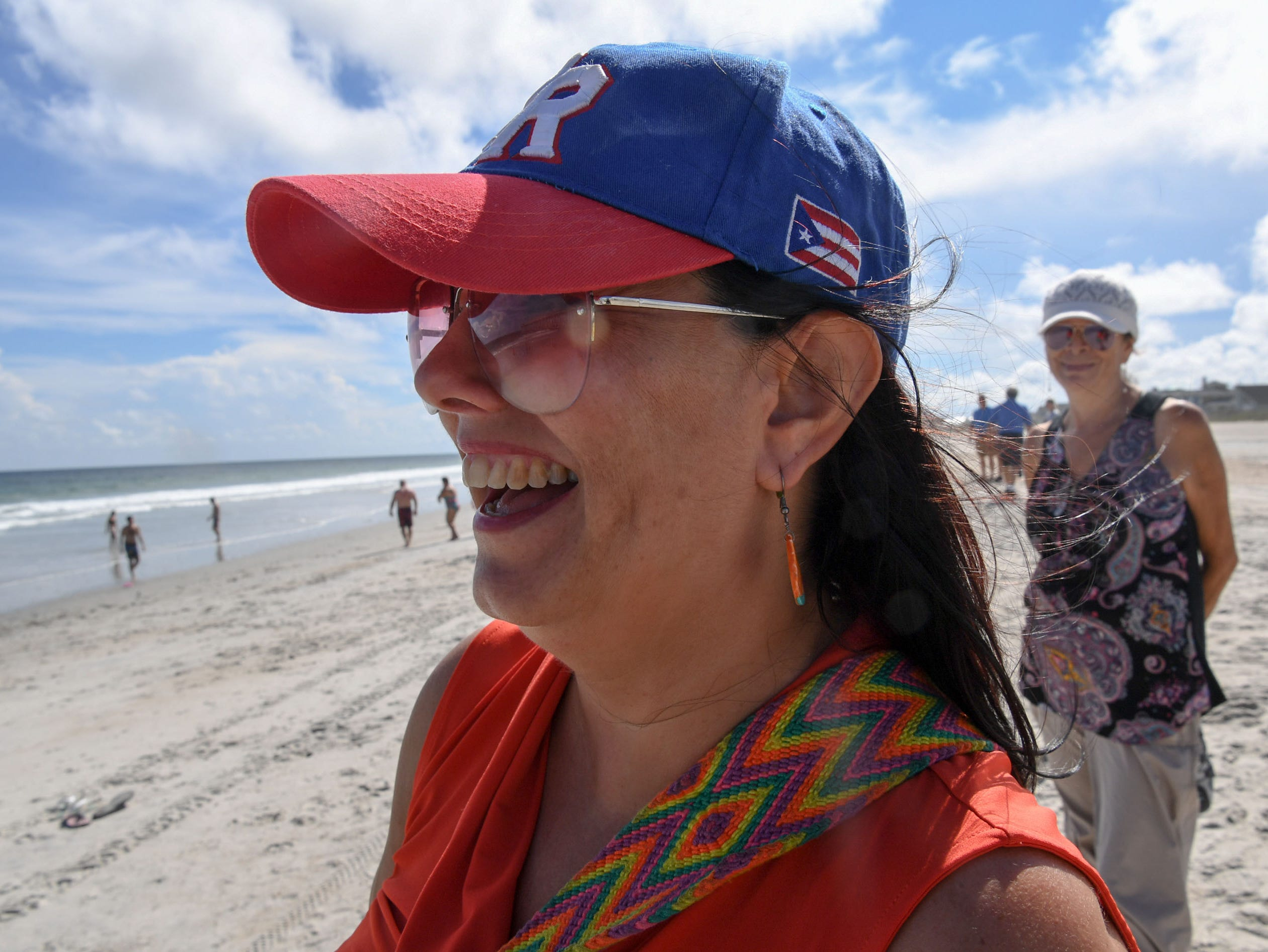 Astrid Villat of Raleigh, North Carolina came back to board up her second home in Wilmington and go for a walk on Wrightville Beach on Tuesday, September 11, 2018. Hurricane Florence is expected to arrive in Wilmington, North Carolina late Thursday night through Friday morning. (Ken Ruinard / Greenville News / Gannett USA Today Network / 2018 )