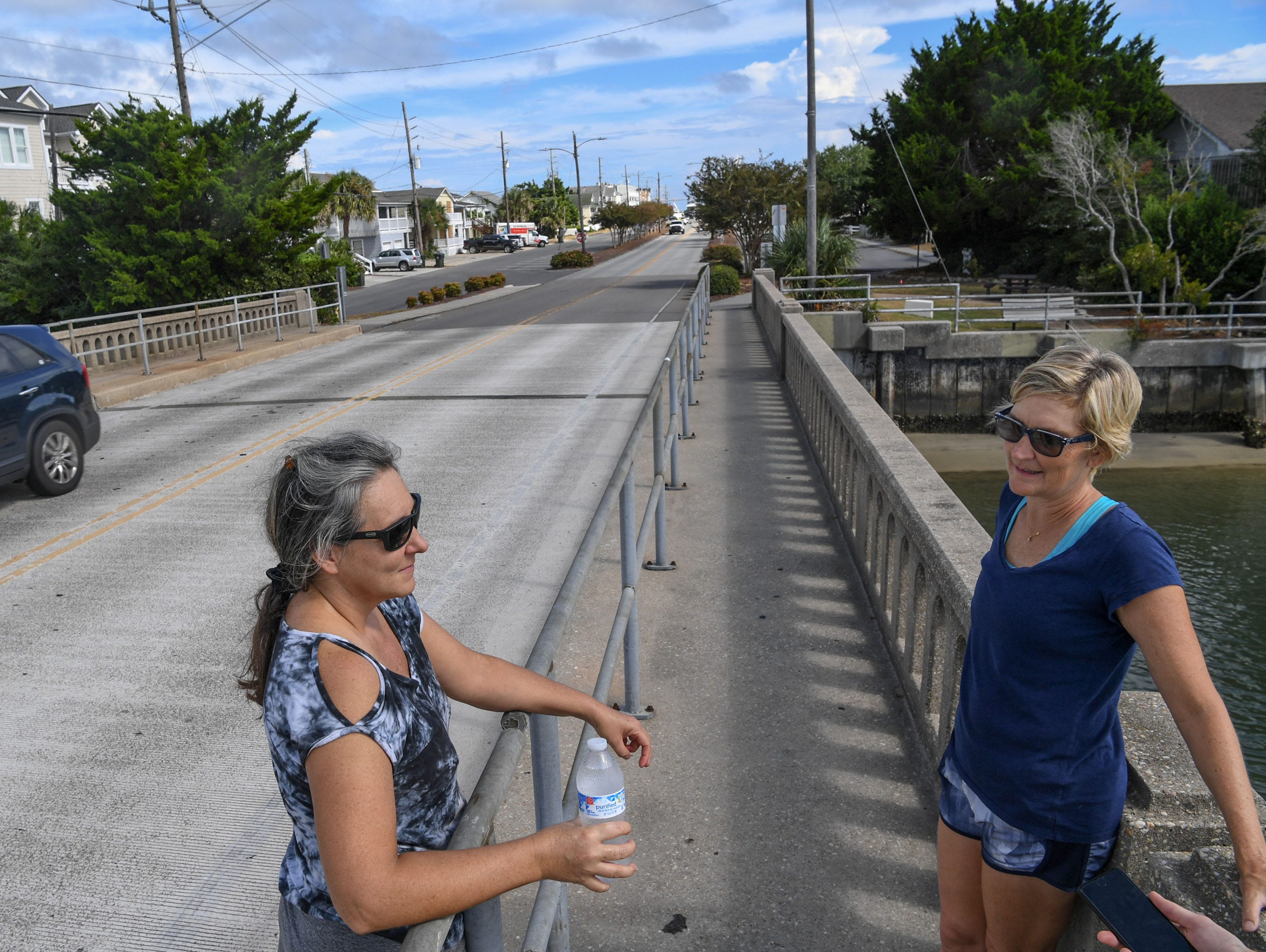 Lori Rosbrugh, left, and Melinda Chipley of Wilmington said they would evacuate Wednesday, going for a walk around Wrightville Beach on Tuesday, September 11, 2018. Hurricane Florence is expected to arrive in Wilmington, North Carolina late Thursday night through Friday morning. (Ken Ruinard / Greenville News / Gannett USA Today Network / 2018 )