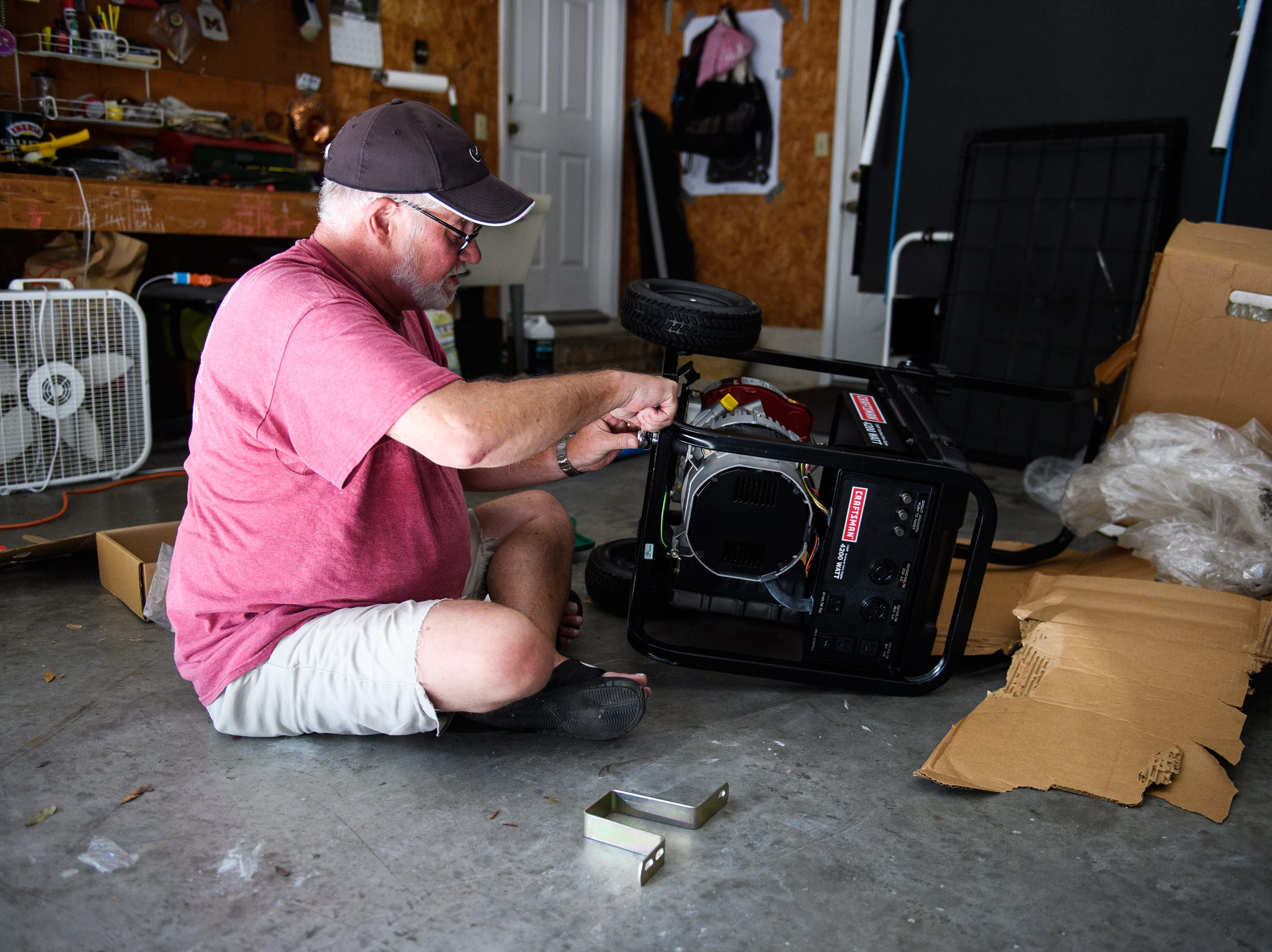 North Myrtle Beach resident Shaun Laughlin puts together a generator in his garage on Tuesday, Sept. 11, 2018 as he prepares for Hurricane Florence's arrival later this week. Laughlin says he will ride out the storm at his mother-in-law's house.