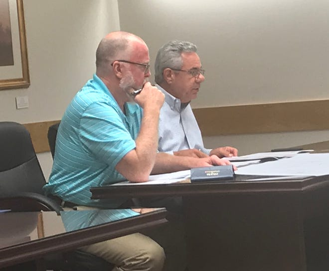 Greg Minton, right, executive vice president of real estate for Spinx, with Norman Hamilton, speaks to the Pickens County Planning Commission about the company's plans for a new store on U.S. 123 near Easley.
