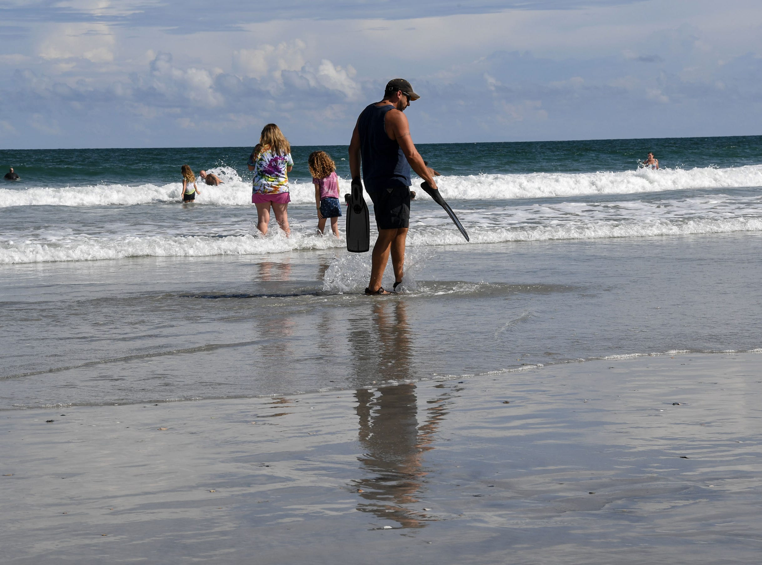 Jeremy Tominack, 40, of Wilmington, North Carolina goes for a walk around Wrightville Beach on Tuesday, September 11, 2018. Hurricane Florence is expected to arrive in Wilmington, North Carolina late Thursday night through Friday morning. (Ken Ruinard / Greenville News / Gannett USA Today Network / 2018 )