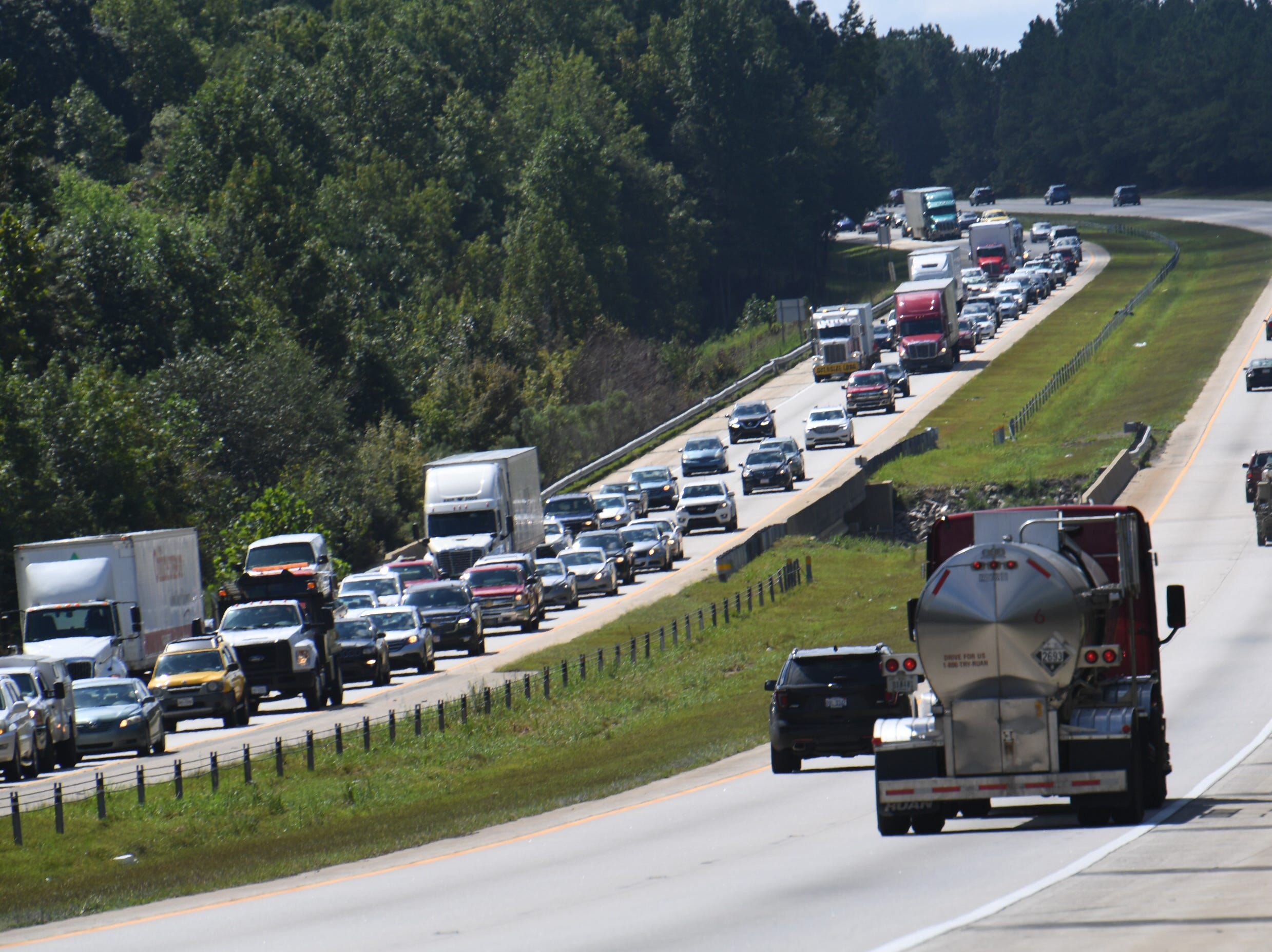 About 100 miles out of Wilmington, N.C., a gas tanker heads toward the city as the city began to evacuate on Tuesday, Sept. 11, 2018, ahead of Hurricane Florence's anticipated landfall later in the week.