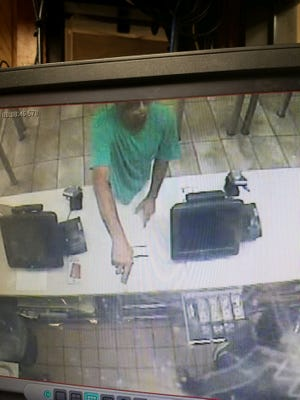 Surveillance photos show a man deputies say is responsible for two armed robberies within a half hour of each other near Pelham Road.
