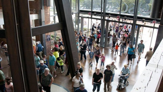 The crowd enters the South Carolina State Museum on opening day of observatory, planetarium and 4D theatre.