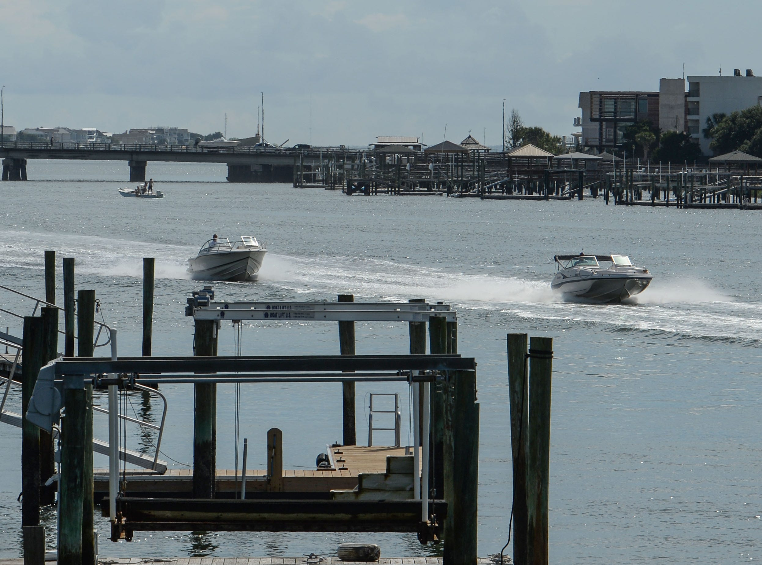 Boats ride on the waterway near Wrightsville Beach in Wilmington, North Carolina on Tuesday, September 11, 2018. Hurricane Florence is expected to arrive in Wilmington, North Carolina late Thursday night through Friday morning. (Ken Ruinard / Greenville News / Gannett USA Today Network / 2018 )