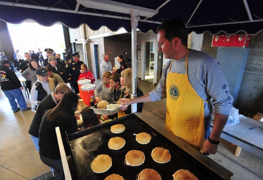 The Great Falls Lions Club makes a pancake breakfast for participants and attendees of the 9/11 remembrance ceremony at Fire Station 1.