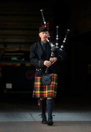 "Jesse Callender of the Great Falls Pipe Band plays ""Amazing Grace"" on the bagpipes for the 9/11 remembrance ceremony, Tuesday morning at Fire Station 1."