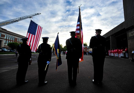 The Great Falls Police color guard presents the flag at the beginning of Tuesday morning's 9/11 remembrance at Fire Station 1.