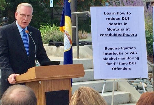 Attorney General Tim Fox speaks at a recent anti-DUI rally in Helena.
