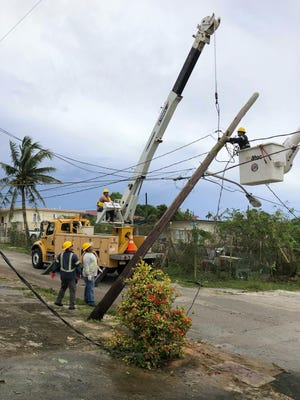 Guam Power Authority crews work to restore electricity in Yigo.