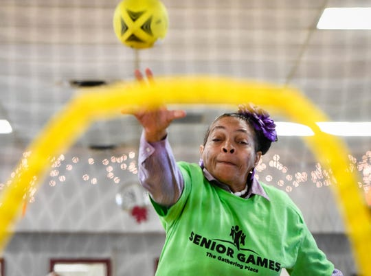 Edith Hall competes in the football throw at the Henderson Senior Games held in the Gathering Place Tuesday, September 11, 2018.