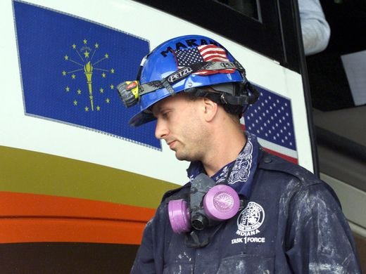 IFD's Ian Marano ends a 16-hour shift working on the World Trade Center wreckage in 2001.