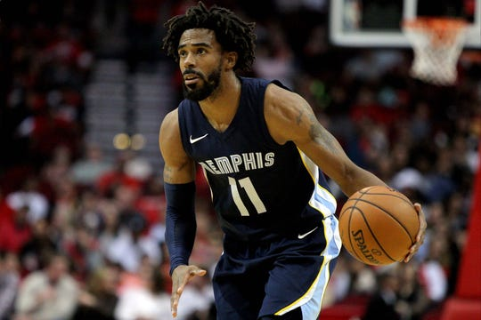 Nov 11, 2017;  Memphis Grizzlies guard Mike Conley (11) handles the ball against the Houston Rockets during the fourth quarter at Toyota Center.