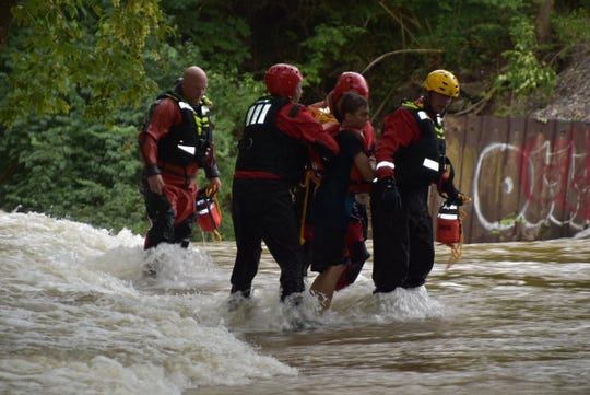 Two boys who were stranded in Fall Creek were in good condition after their rescue, Indianapolis firefighters said.