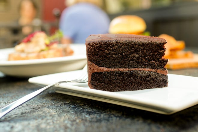 At Rail Restaurant and Bar in Westfield Ind., Rail's Signature Double Chocolate Cake, $8, is packed with chocolate on Tuesday, Sept. 11, 2018.
