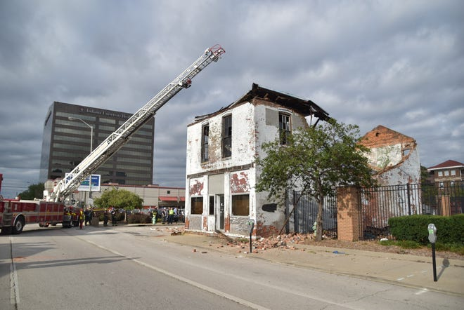 One firefighter was slightly injured when this two-story brick building at the corner of Ninth and Illinois streets collapsed on Monday, Sept. 10, 2018.