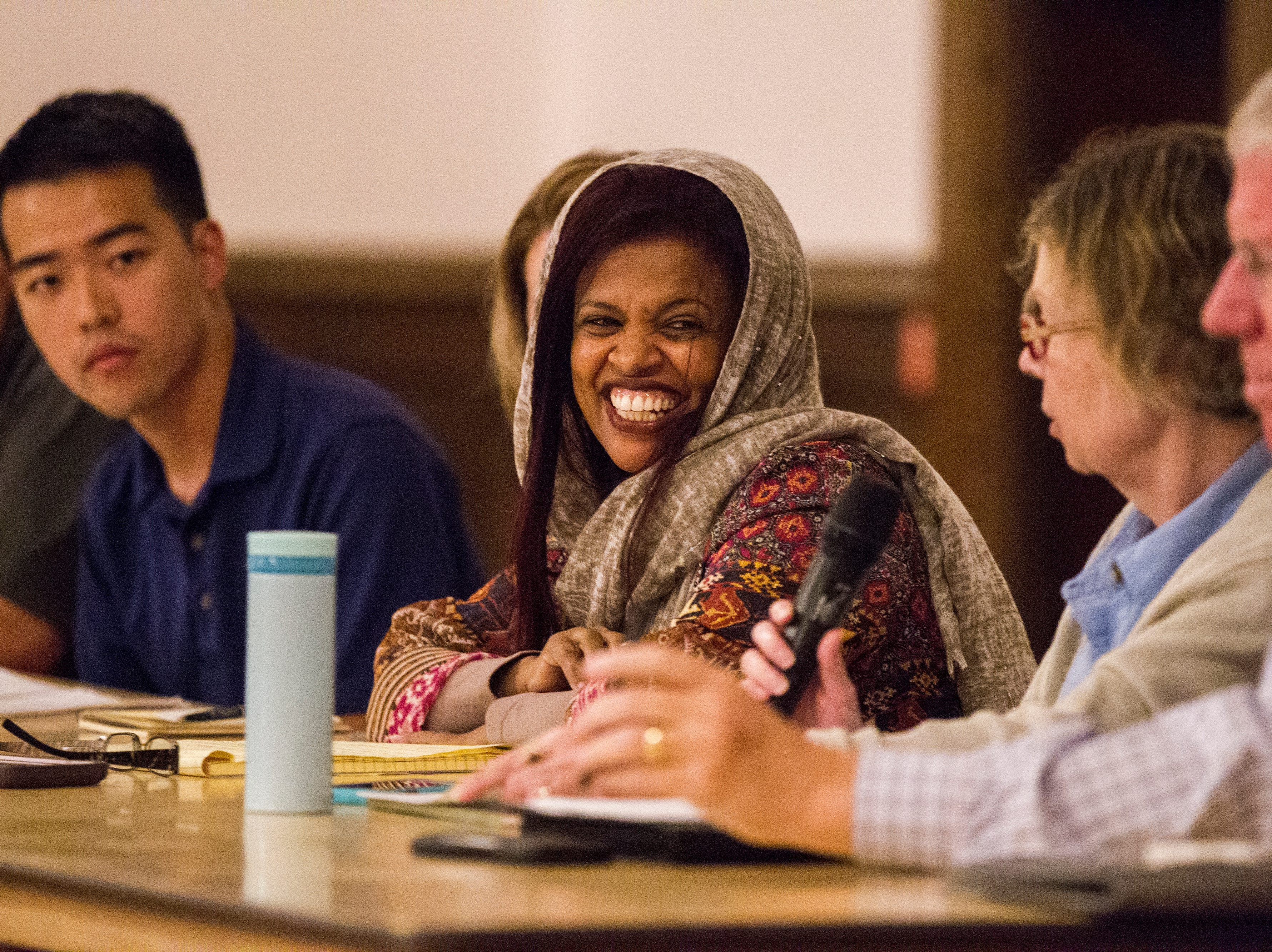 "Iowa City Councilor Mazahir Salih laughs during a public hearing organized by members of the ""Save Our Labor Center coalition"" on Monday, Sept. 10, 2018, at Old Brick in Iowa City."