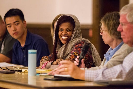 "Iowa City Council member Mazahir Salih laughs during a public hearing organized by members of the ""Save Our Labor Center coalition"" on Monday, Sept. 10, 2018, at Old Brick in Iowa City."