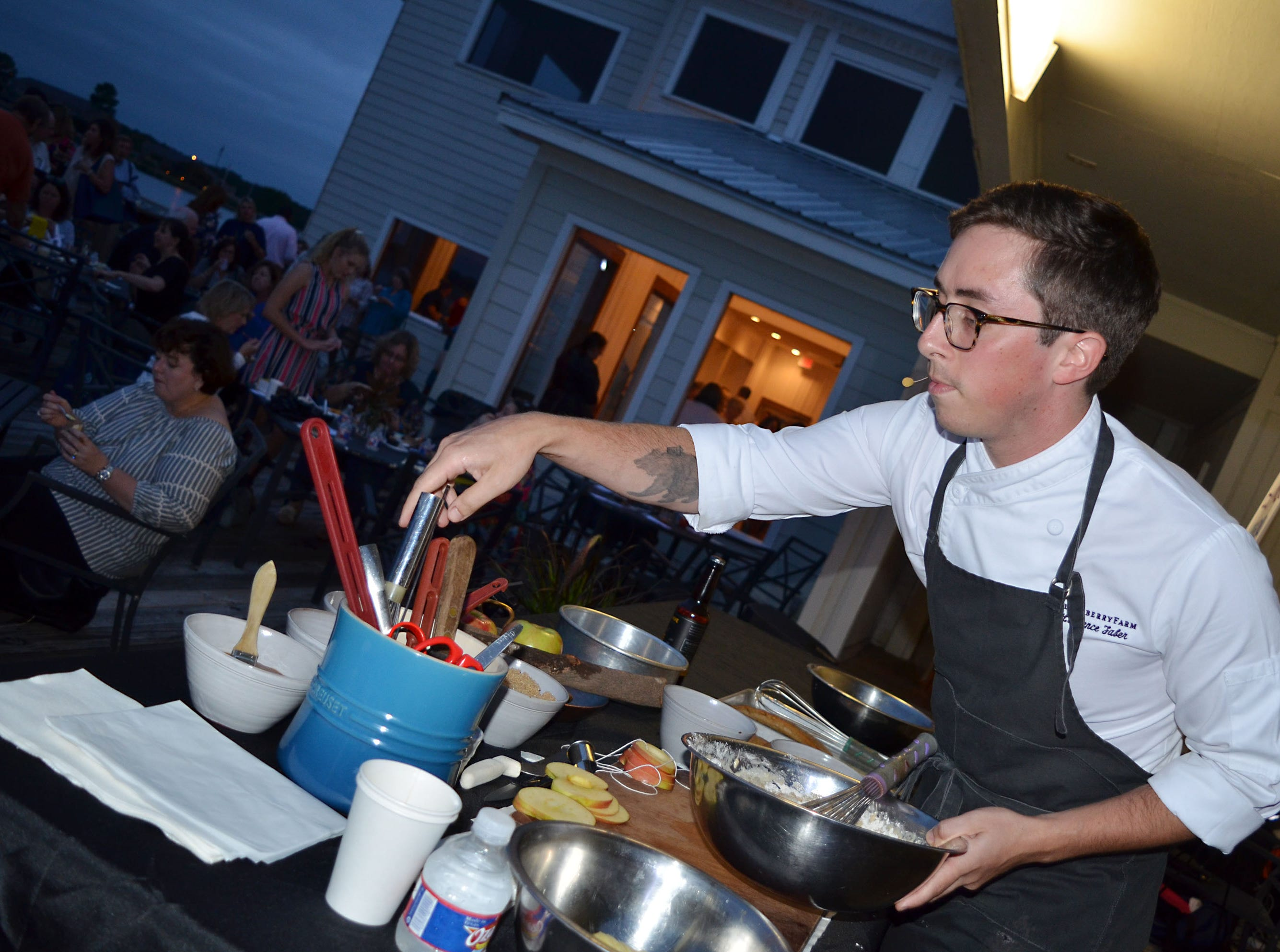 Laurence Faber with Blackberry Farm of Walland, Tennessee,  prepares apple cake during The Sweetest Chefs event held Monday.