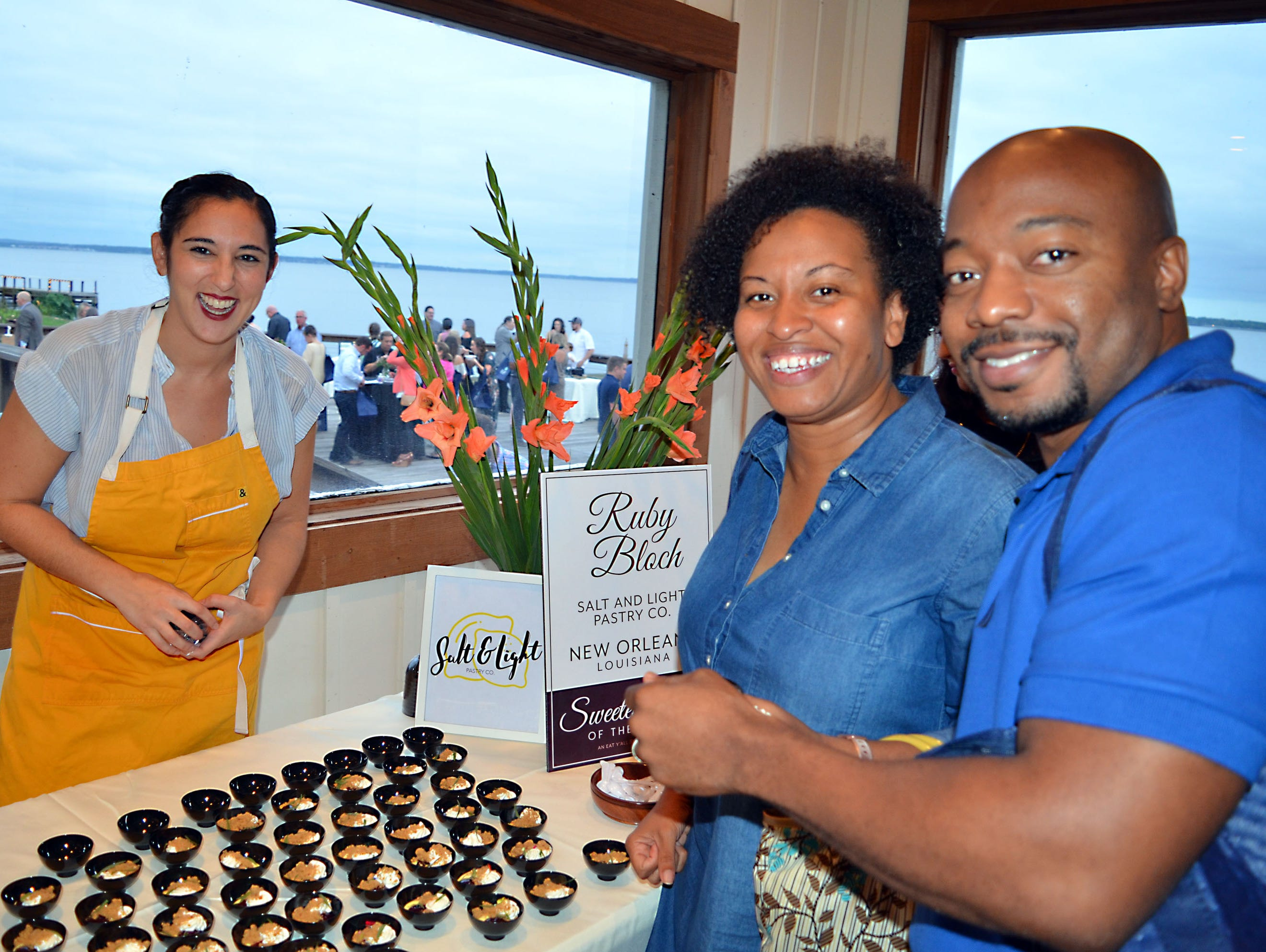 Nathaniel Taylor, from left, of Yazoo City, and Kemba Taylor, of Jackson, enjoy desserts prepared by pastry chef Ruby Bloch with Salt and Light Pastry Co. of New Orleans.