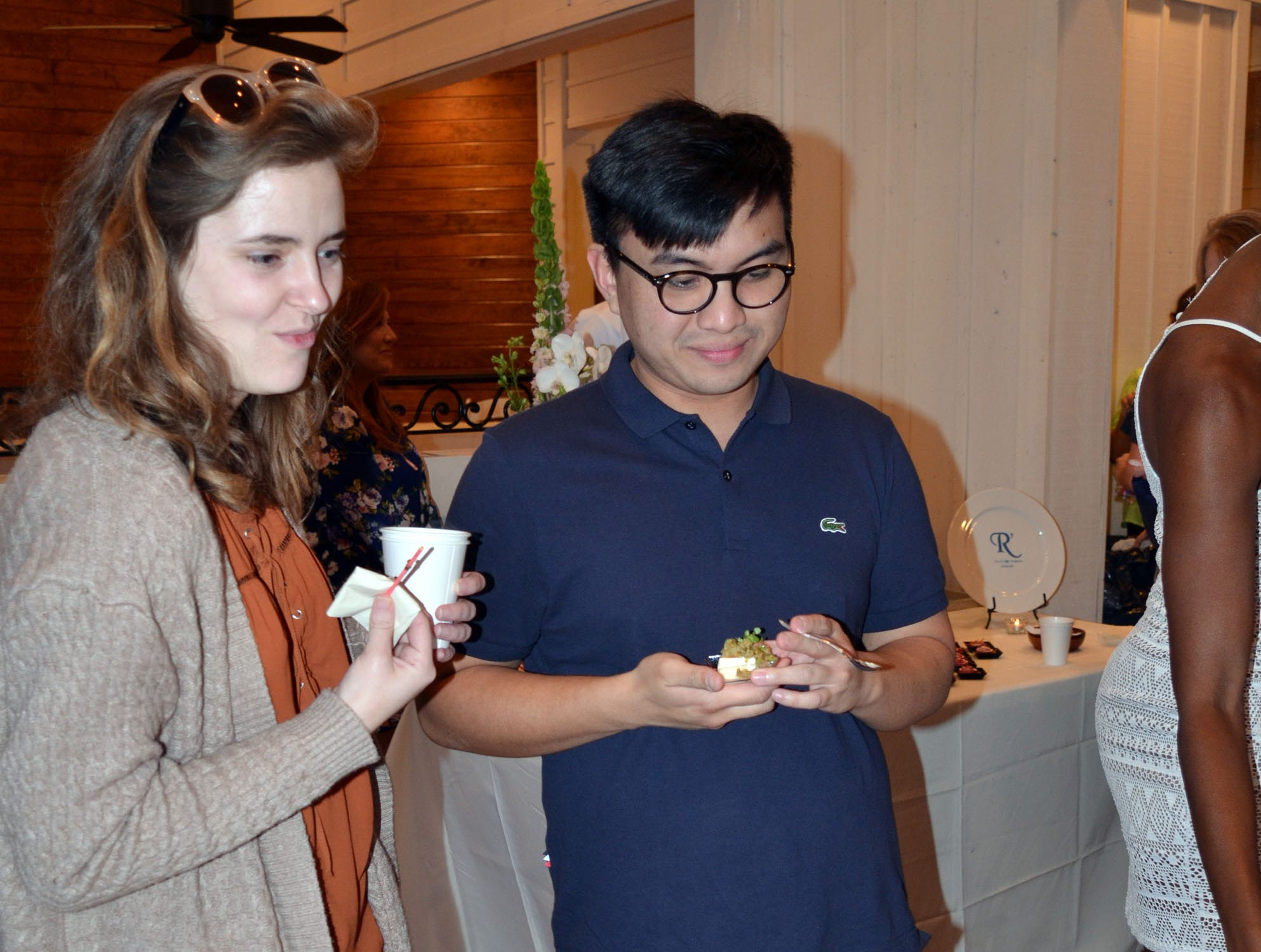 Rylie Byrd, left, of Jackson, and Kevin Drapeza, right, of Jackson, enjoy the butterscotch panna cotta with apple honey and pumpkin seeds prepared by pastry chef Josh Lear of The Noble South in Mobile, Alabama.
