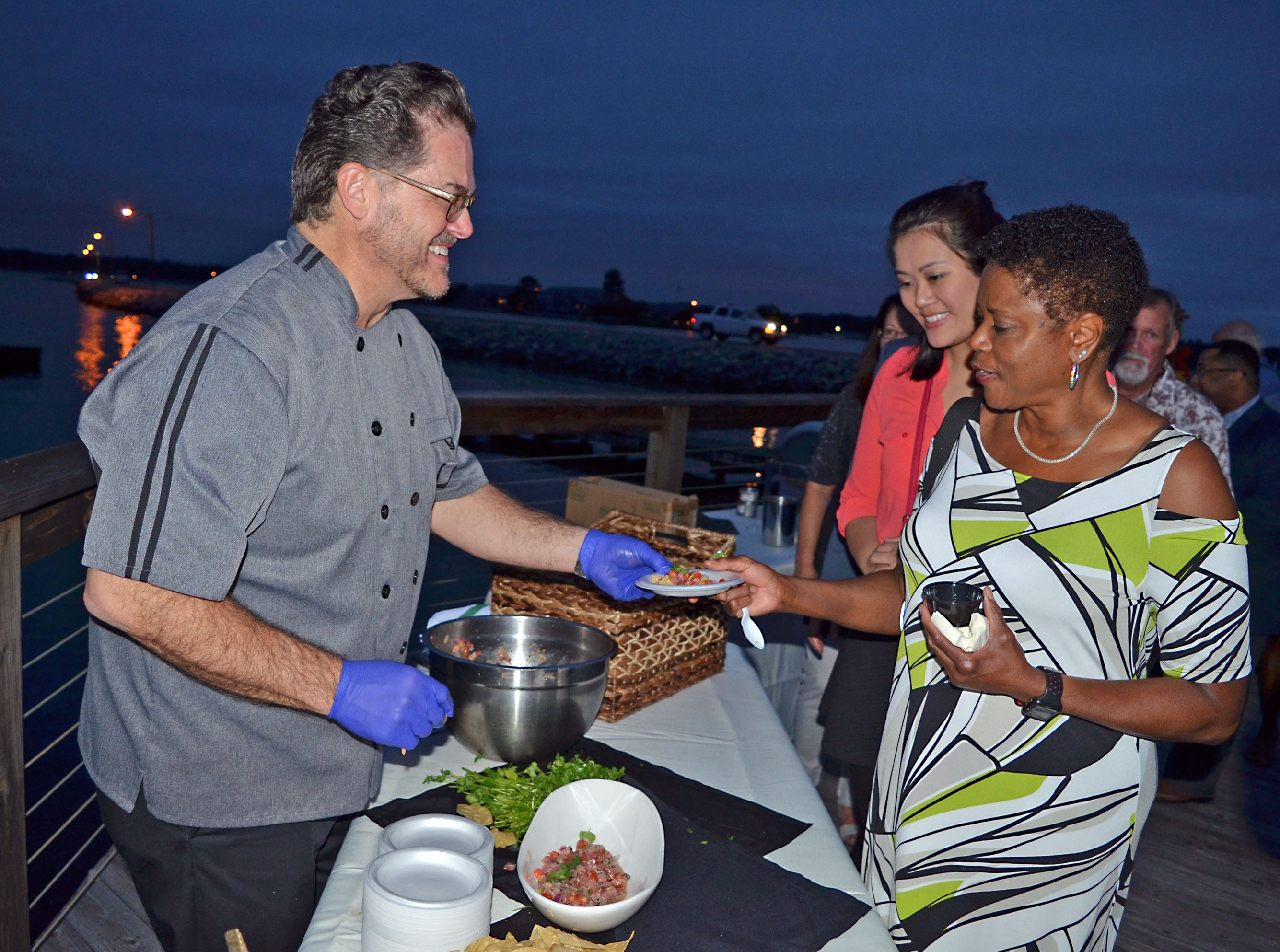Ken Crotwell with Sombra Mexican Restaurant serves Towanda Sharkey of Jackson during the Sweetest Chefs event.