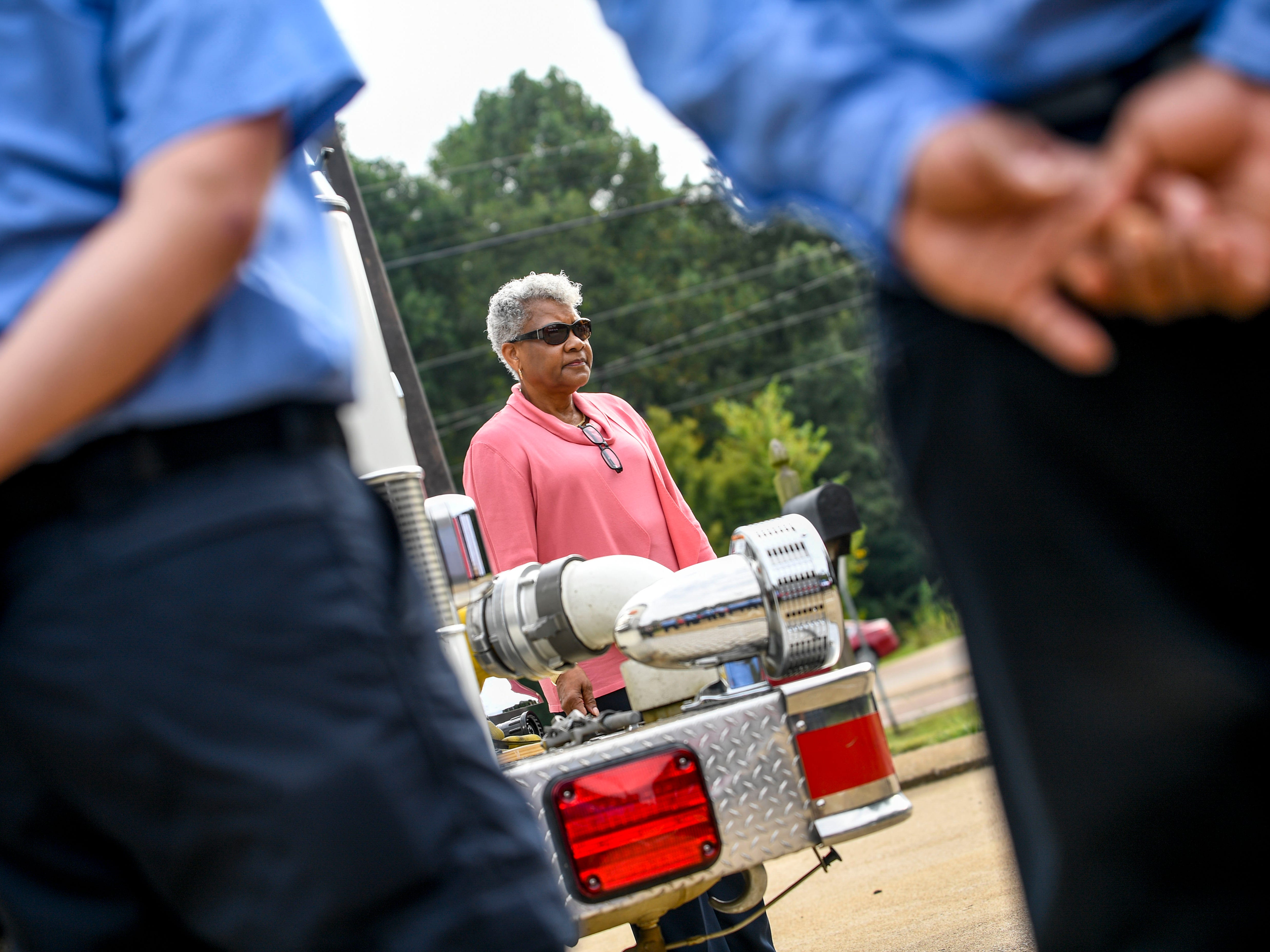 Personal director Lynn Henning prepares to ring a bell on the front bumper of a fire engine during a ceremony honoring the victims of the 9/11 attacks at Fire Station 3 in Jackson, Tenn., on Tuesday, Sept. 11, 2018.