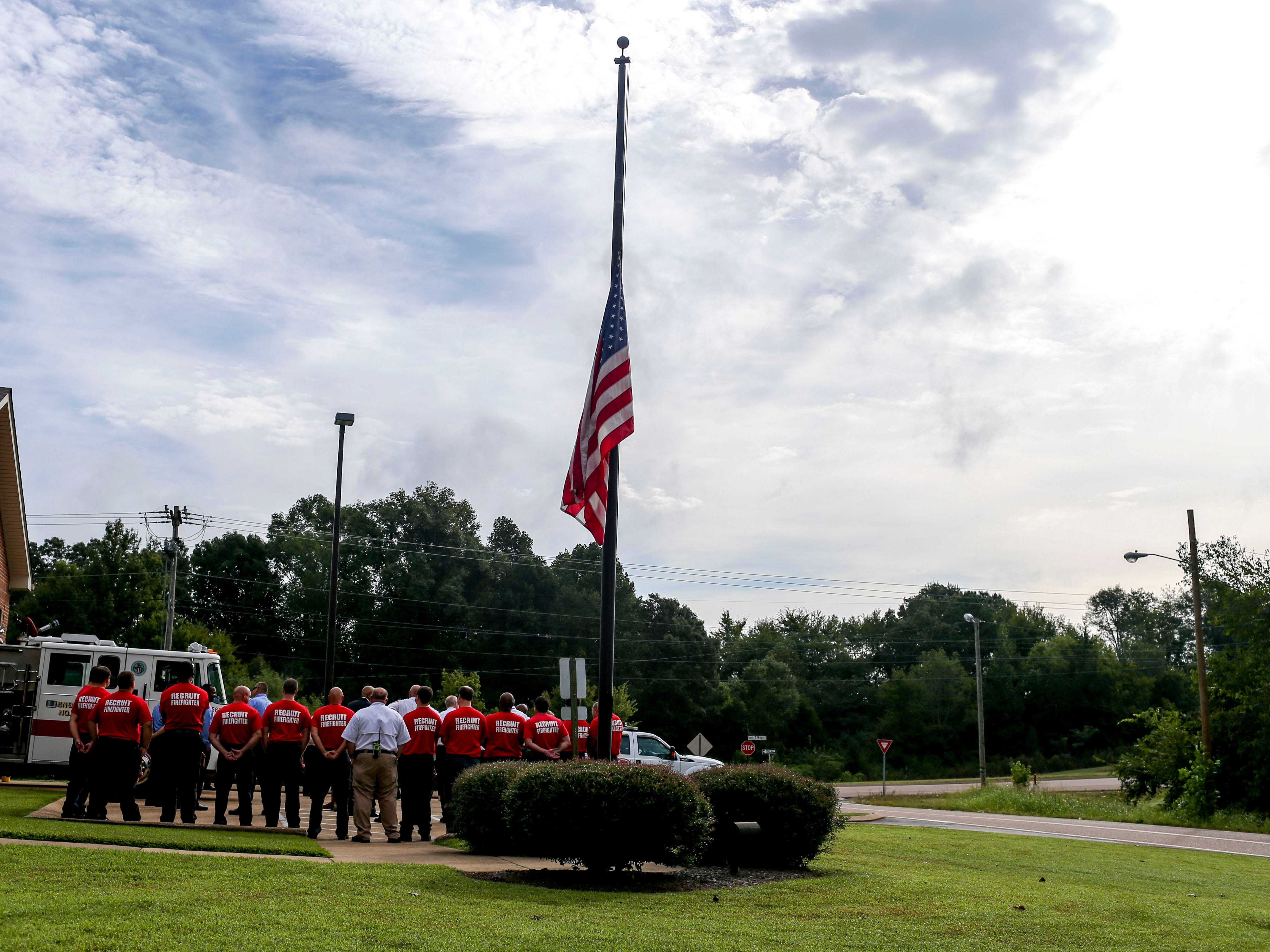 The American flag is flown at half mast during a ceremony honoring the victims of the 9/11 attacks at Fire Station 3 in Jackson, Tenn., on Tuesday, Sept. 11, 2018.
