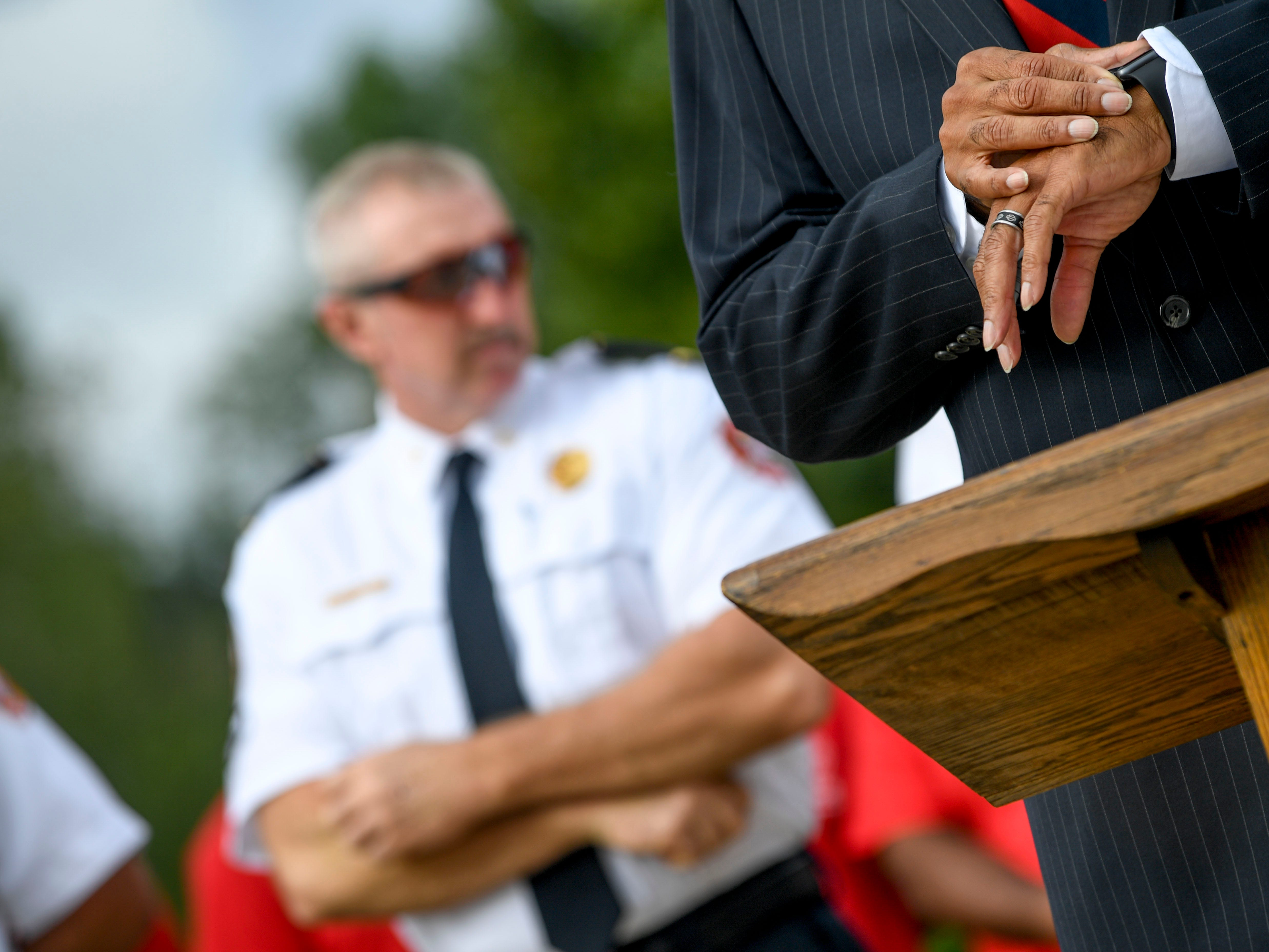 Fire Chief Darryl Samuels checks his watch before the start of a ceremony honoring the victims of the 9/11 attacks at Fire Station 3 in Jackson, Tenn., on Tuesday, Sept. 11, 2018.