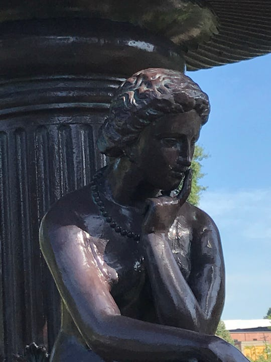 The Ella Albers Memorial Fountain includes two women who are seated and mourning. The fountain is a recreation of one placed in Old Gray Cemetery in 1890 by A.J. Albers to remember his young wife.