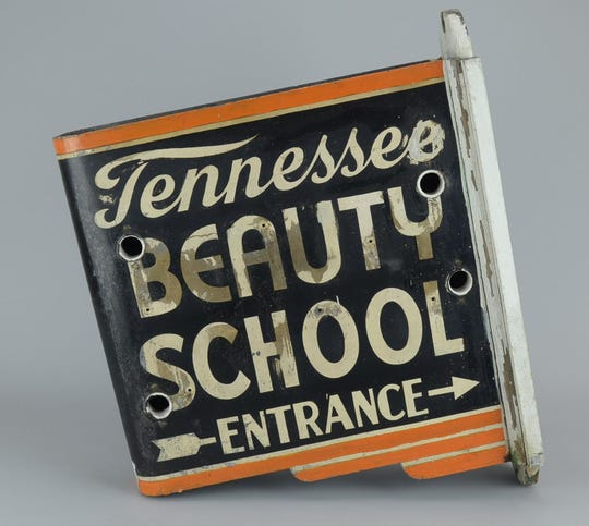 This discarded Tennessee School of Beauty sign has been preserved and is part of a new Museum of East Tennessee History exhibit.