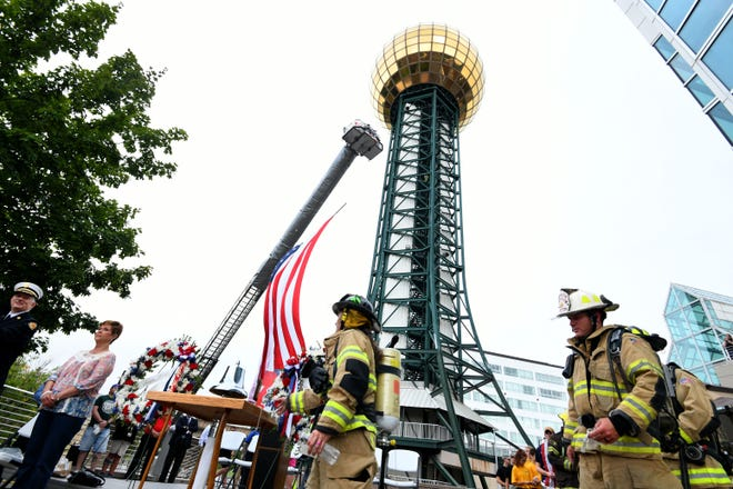 After completing the 2018 Knoxville 9/11 Memorial Stair Climb at the Sunsphere Tuesday, September 11, 2018 climbers read the name of the person they were honoring and ring the bell. About 130 climbers took part in the event meant to honor those emergency workers who lost their lives on Sept. 11.
