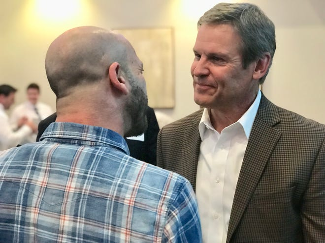 Tennessee Republican gubernatorial nominee Bill Lee speaks to an attendee after a campaign stop in Knoxville on Tuesday, Sept. 11.