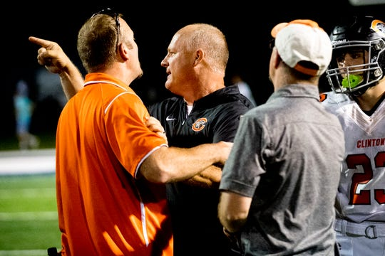 Clinton football coach Randy McKamey yells back at Anderson County offensive line coach Russ Gillum after getting into an apparent altercation following a  game between Anderson County and Clinton at Anderson County High School in Clinton, Tennessee on Thursday, September 6, 2018.