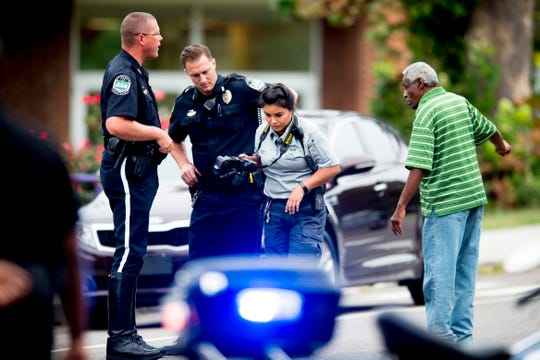 First responders investigate in front of Vine Middle School where a child was hit by a vehicle in Knoxville, Tennessee on Tuesday, September 11, 2018.