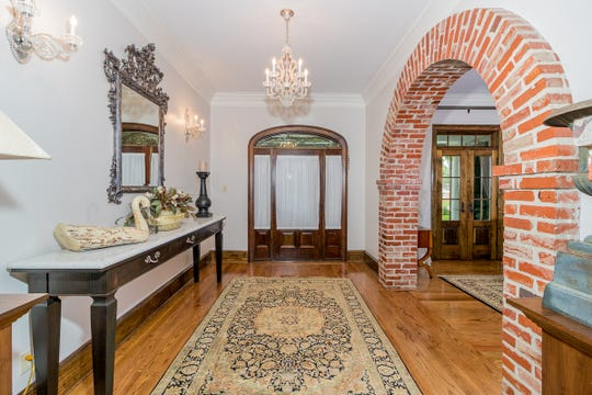 The grand entrance has gorgeous brick accents.