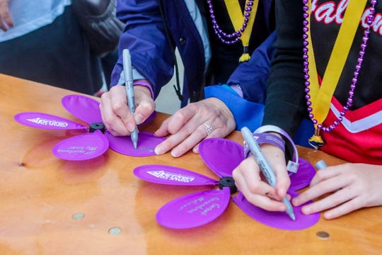 Purple flowers represent those who have lost their lives to Alzheimer's disease.