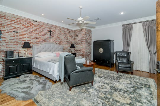 The master bedroom includes designer colors and touches.