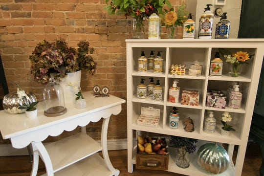 A variety of liquid and bar soaps, mixed in with home decor items, on display at the Dragonfly Emporium, shown Tuesday, Sept. 11, 2018.