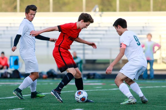Gavin White (center) was the leading scorer on Pinckney's soccer team last fall while also leading the cross country team as a freshman.
