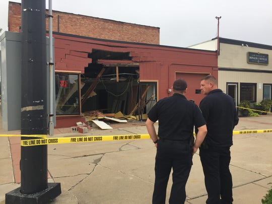 A large hole in the side of the vacant Safe Start Driving Academy building in downtown Howell Tuesday, Sept. 11, 2018. Police say a pickup truck crashed into the building about 9 a.m.