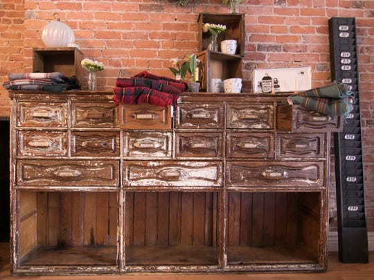 A chest of drawers that came from an apothecary store displays some of the products that will be offered at Dragonfly Emporium, shown Tuesday, Sept. 11, 2018.