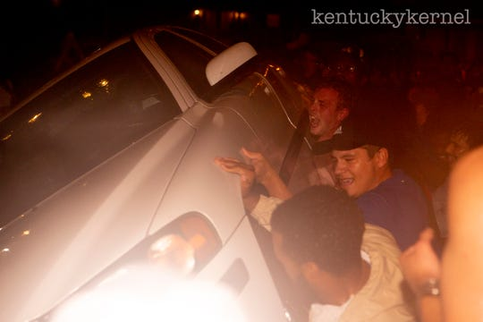 Crowds flipped a car on State Street in Lexington after UK football beat Florida 27,16, ending a 31-year losing streak.